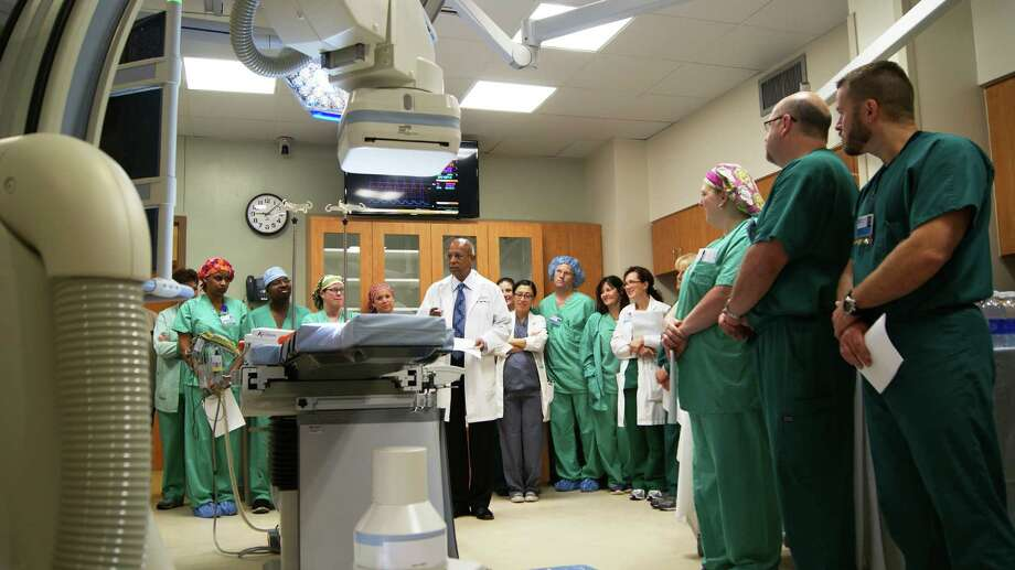 Dr. Aiyanadar Bharathi speaks to a group of hospital employees at the dedication of the new catheterization lab at Christus Hospital St. Elizabeth. Photo: Courtesy Photo