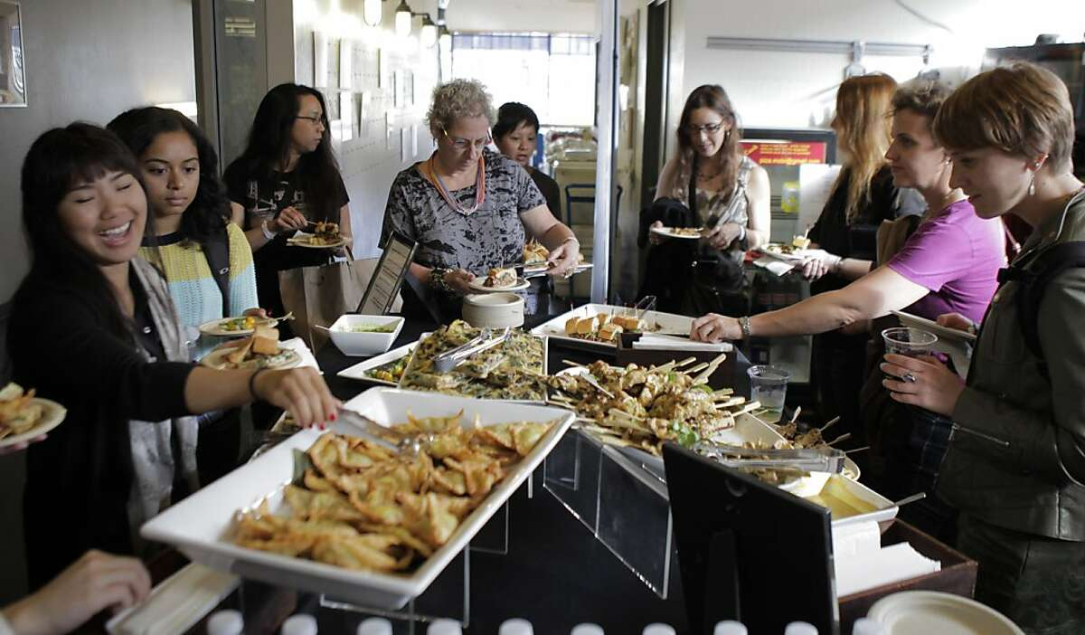 Girl Geek participants load up on food at the the Girl Geek Dinner at Techshop on Wednesday. Autodesk and Instructables hosted Girl Geek Dinner at Techshop in San Francisco, Calif., on Wednesday, August 14, 2013, where women interested in tech and networking were given a tour of the facility and heard from Brit Morin, the founder of Brit & Co.