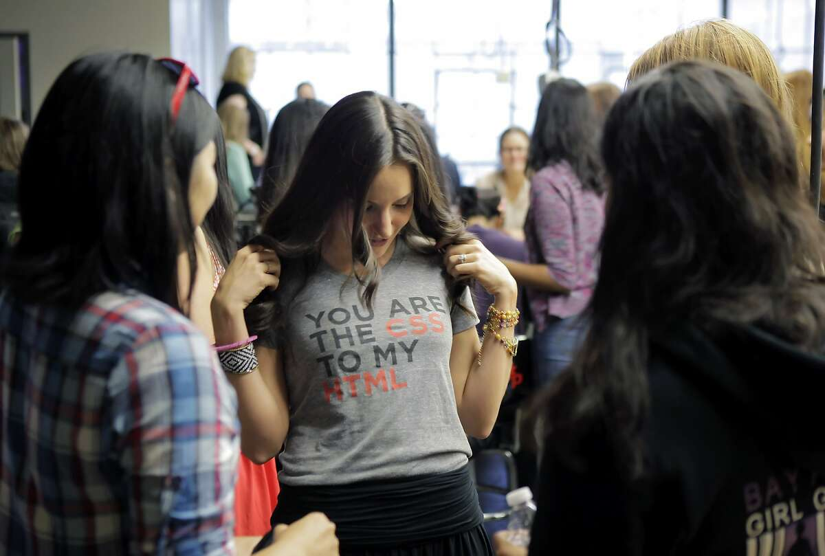 Brit Morin shows off her T-shirt that reads,