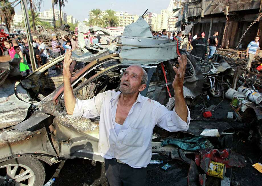 A man prays Friday after a car bombing outside Taqwa mosque in Tripoli, Lebanon. Bombings at two mosques raised fears of widespread sectarian warfare. Photo: Bilal Hussein, STF / AP