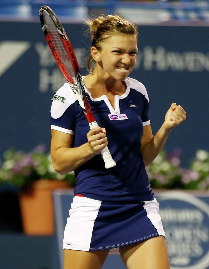 NEW HAVEN, CT - AUGUST 23:  Simona Halep of Romania celebrates her match win over Caroline Wozniacki of Denmark during Day Six of the New Haven Open at Yale at the Connecticut Tennis Center on August 23, 2013 in New Haven, Connecticut. Photo: Elsa, Getty Images / 2013 Getty Images