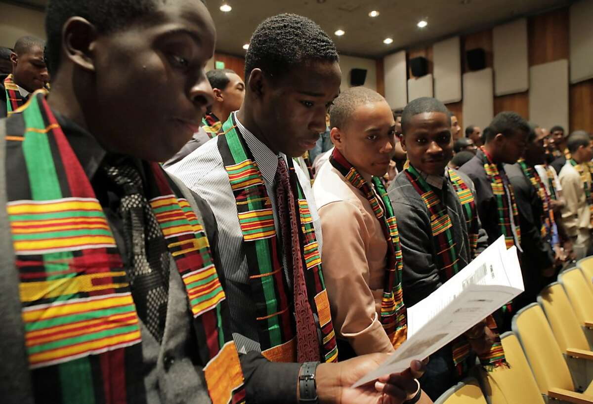 (l-r) Emmanuel Essian, Jaemont Moore, Stanley Edwards, and George Baidoo, recite a pledge during at a graduation for student members of the College Bound Brotherhood at the Oakland Museum of California in Oakland, Calif., on Wednesday, June 19, 2013.