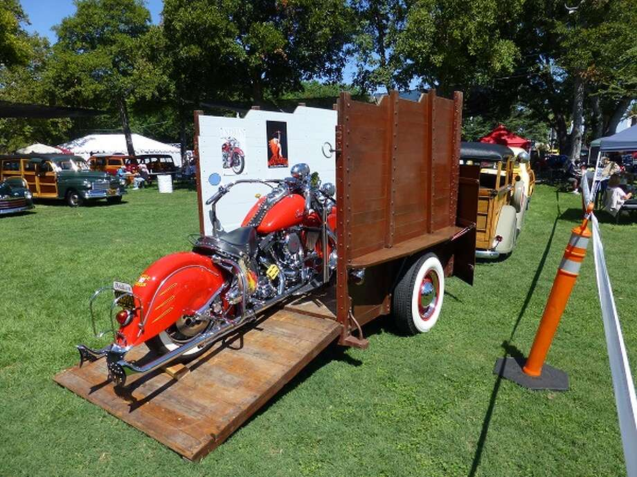 An Indian motorcycle on the ramp to its trailer.
