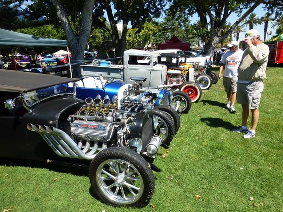 A row of older hot rods.