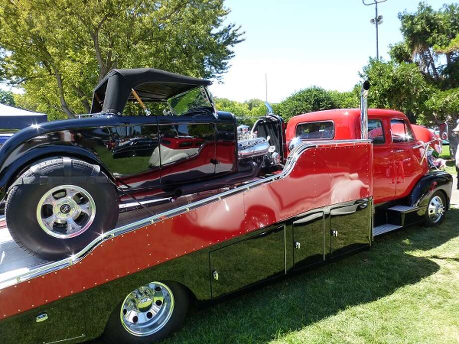 An old Ford is trailered to the show in the style to which it has become accustomed.