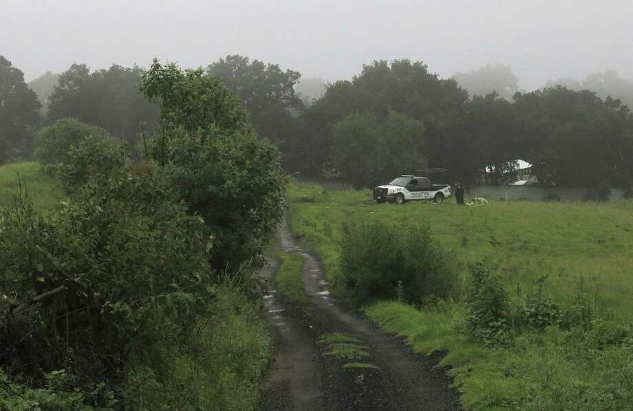 A police vehicle sits at the entrance to a ranch in Tlalmanalco, on the rural outskirts of Mexico City, where investigators searched for more bodies Friday. Photo: Adriana Gomez / Associated Press