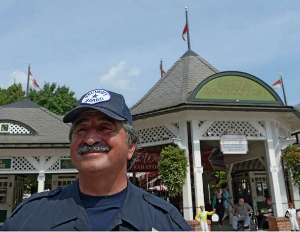 Len Rizzo, NYRA Employee of the Week, stands at his station near the clubhouse entrance Thursday, Aug. 22, 2013, at Saratoga Race Course in Saratoga Springs, N.Y.  (Skip Dickstein/Times Union) Photo: SKIP DICKSTEIN