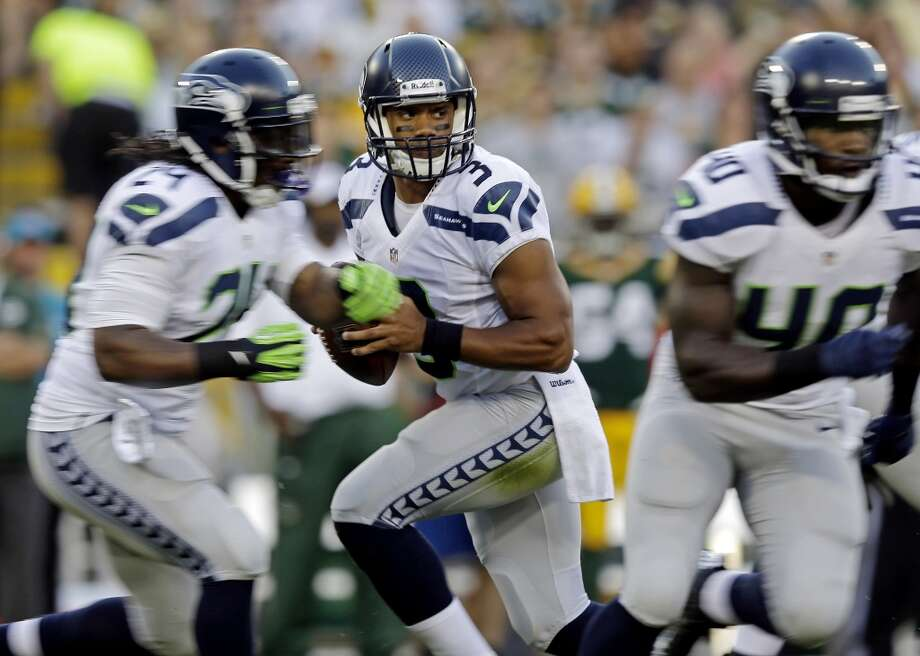 Seattle Seahawks' Russell Wilson drops back to pass during the first half of an NFL preseason football game against the Green Bay Packers Friday, Aug. 23, 2013, in Green Bay, Wis. (AP Photo/Morry Gash) Photo: AP