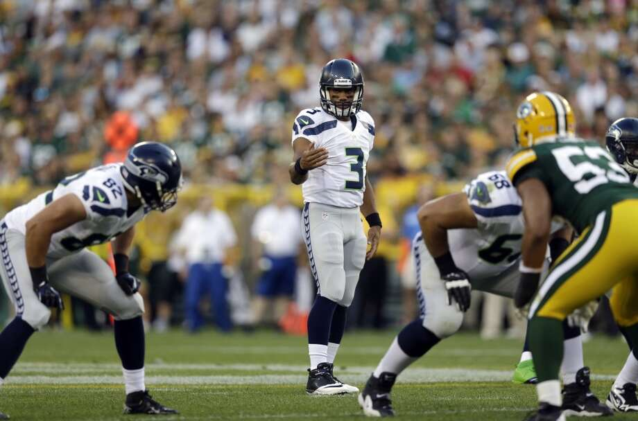 Seattle Seahawks' Russell Wilson during the first half of an NFL preseason football game against the Green Bay Packers Friday, Aug. 23, 2013, in Green Bay, Wis. (AP Photo/Morry Gash) Photo: AP