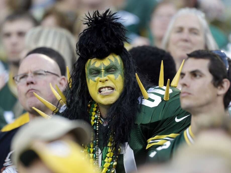 Fans during the first half of an NFL preseason football game between the Green Bay Packers and the Seattle Seahawks Friday, Aug. 23, 2013, in Green Bay, Wis. (AP Photo/Jeffrey Phelps) Photo: AP