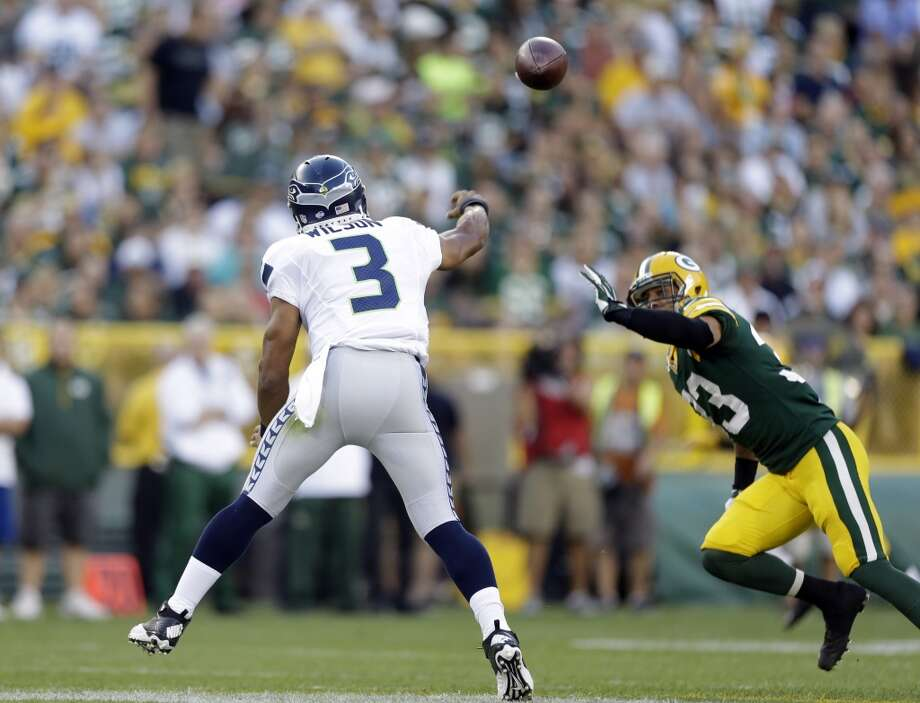 Seattle Seahawks' Russell Wilson during the first half of an NFL preseason football game against the Green Bay Packers Friday, Aug. 23, 2013, in Green Bay, Wis. (AP Photo/Jeffrey Phelps) Photo: AP