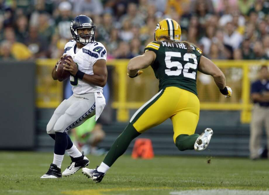 Seattle Seahawks' Russell Wilson with Green Bay Packers' Clay Matthews (52) rushing during the first half of an NFL preseason football game Friday, Aug. 23, 2013, in Green Bay, Wis. (AP Photo/Morry Gash) Photo: AP