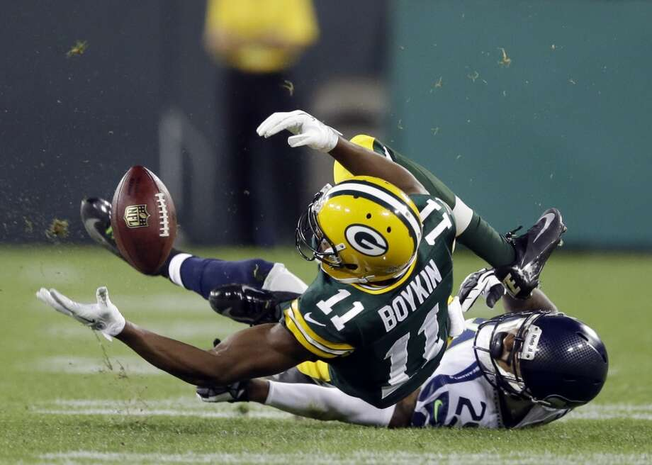 Green Bay Packers' Jarrett Boykin (11) fumbles as he is tackled by Seattle Seahawks' Earl Thomas (29) during the first half of an NFL preseason football game Friday, Aug. 23, 2013, in Green Bay, Wis. The Seahawks recovered the ball. (AP Photo/Tom Lynn) Photo: AP