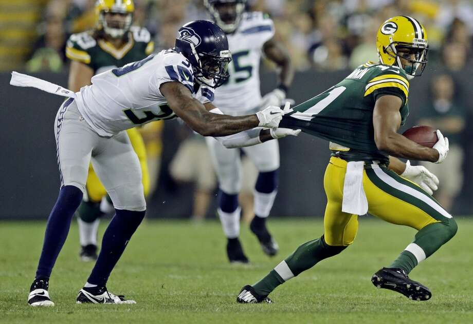 Seattle Seahawks' Brandon Browner tries to tackle Green Bay Packers' Jarrett Boykin during the first half of an NFL preseason football game Friday, Aug. 23, 2013, in Green Bay, Wis. (AP Photo/Morry Gash) Photo: AP