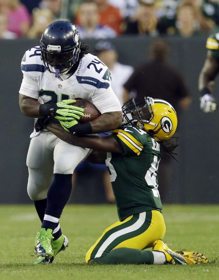 Seattle Seahawks' Marshawn Lynch tries to run past Green Bay Packers' M.D. Jennings during the first half of an NFL preseason football game Friday, Aug. 23, 2013, in Green Bay, Wis. (AP Photo/Tom Lynn) Photo: AP