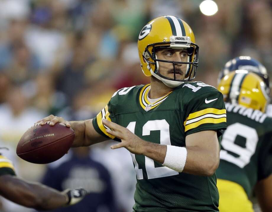 Green Bay Packers' Aaron Rodgers during the first half of an NFL preseason football game against the Seattle Seahawks Friday, Aug. 23, 2013, in Green Bay, Wis. (AP Photo/Tom Lynn) Photo: AP