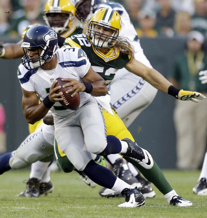 Green Bay Packers' Clay Matthews sacks Seattle Seahawks quarterback Russell Wilson during the first half of an NFL preseason football game Friday, Aug. 23, 2013, in Green Bay, Wis. (AP Photo/Jeffrey Phelps) Photo: AP
