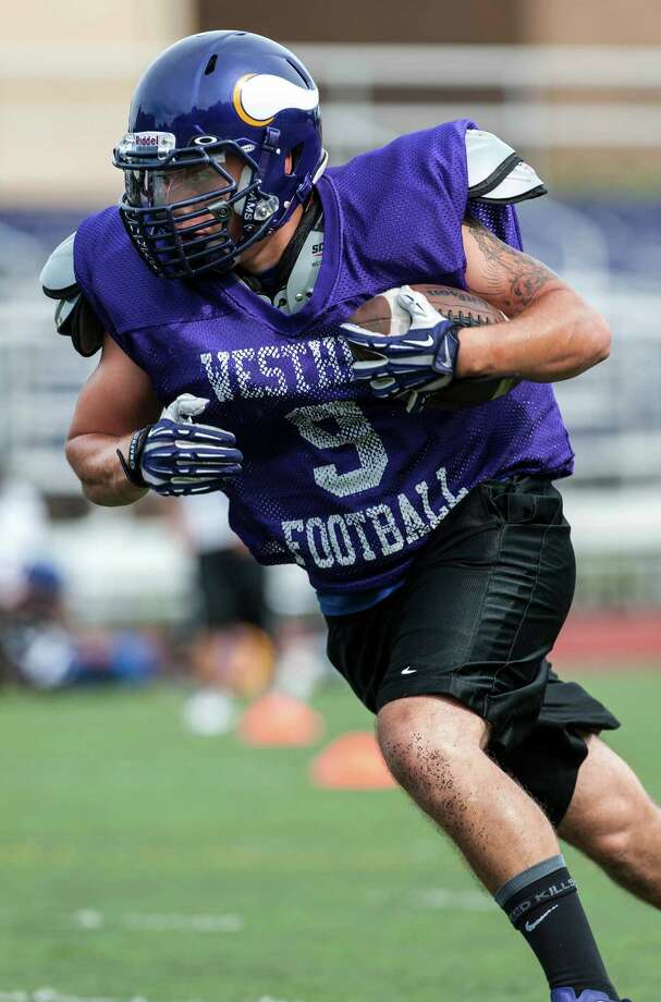 The Westhill high school football team during a preseason practice at Westhill high school, Stamford, CT on Friday, August 23rd, 2013. Photo: Mark Conrad / Stamford Advocate Freelance