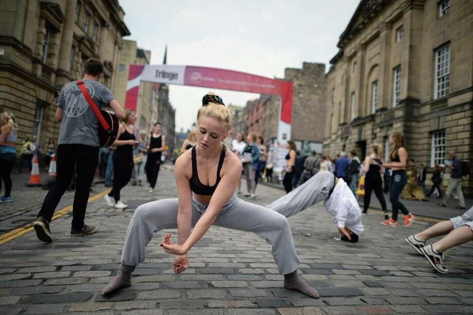 Edinburgh Festival Fringe entertainers perform on the Royal Mile as the festival enters its final weekend on August 23, 2013 in Edinburgh, Scotland. The largest performing arts festival in the world has been running for the past three weeks and has enjoyed an increase in venues and visitors compared with previous years. Photo: Jeff J Mitchell, Getty Images / 2013 Getty Images
