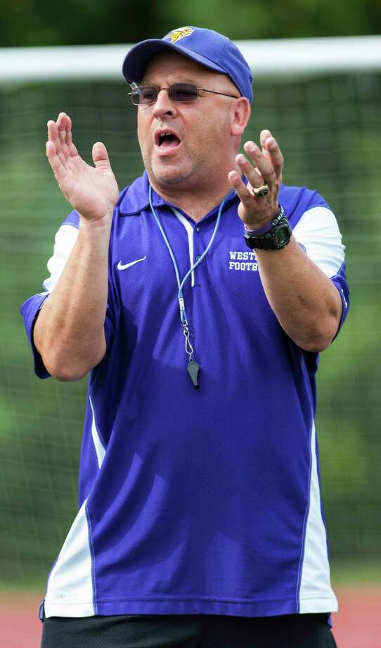 Westhill high school football head coach Frank Marcucio leading his team during a preseason practice at Westhill high school, Stamford, CT on Friday, August 23rd, 2013. Photo: Mark Conrad / Stamford Advocate Freelance