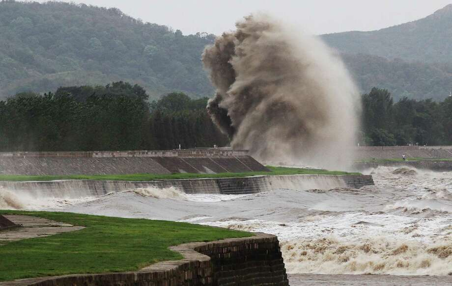 A tidal wave hits a bank along the Qiantang River on August 22, 2013 in Haining, China. The 12th typhoon Trami landed in Fujian province at 2:40 am and led gales and heavy rainfalls in east China. Photo: ChinaFotoPress, Getty Images / 2013 Getty Images