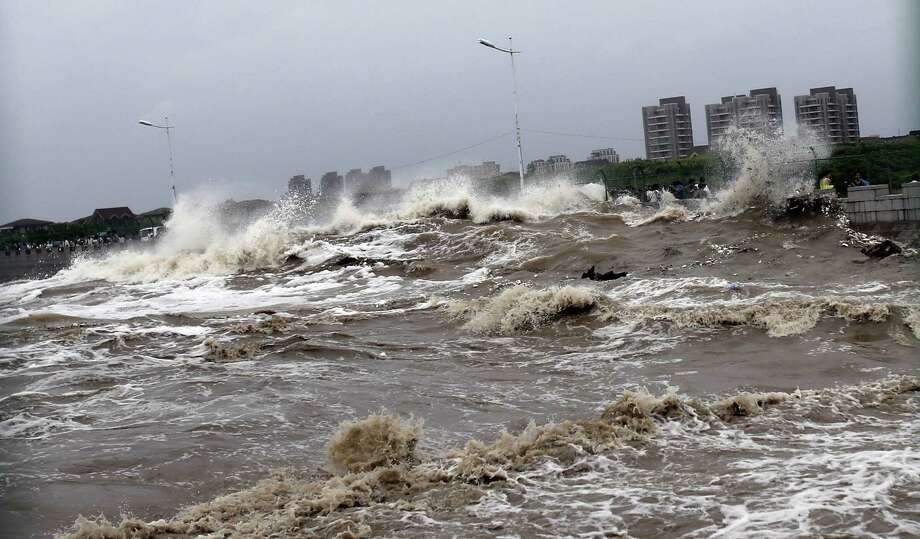 "This picture taken on August 22, 2013 shows huge waves from the ""Haining tide"" - a daily occurrence when the river tides hit the banks of the city - surging higher than usual due to the influence of Typhoon Trami in the region in Haining, in eastern China's Zhejiang province. Photo: STR, AFP/Getty Images / AFP"
