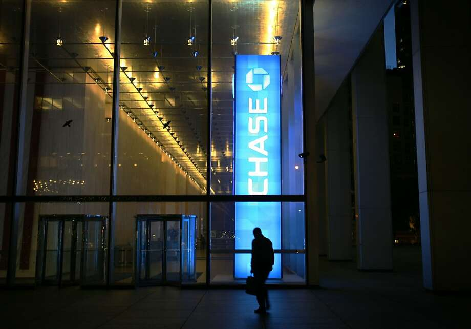 Six years after the mortgage meltdown, with refinances plummeting, JPMorgan Chase and other banks are cutting jobs - 15,000 at Chase by the end of 2014. Photo: Mark Lennihan, Associated Press