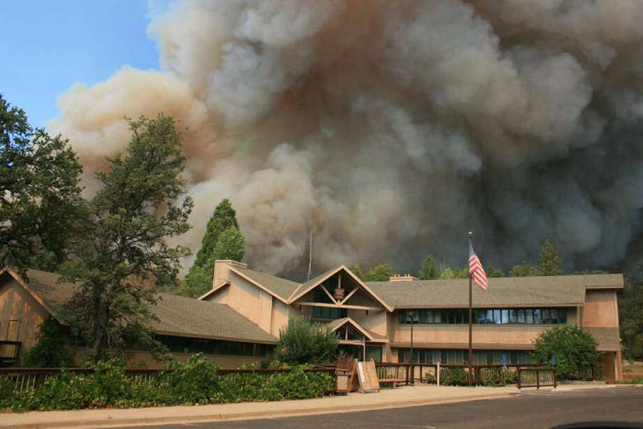 A week-old wildfire burns close to Groveland Ranger Station near Yosemite National Park, Calif., on Friday. The fire is one of more than 50 major brush blazes burning across the western United States. Photo: U.S. Forest Service / Getty Images