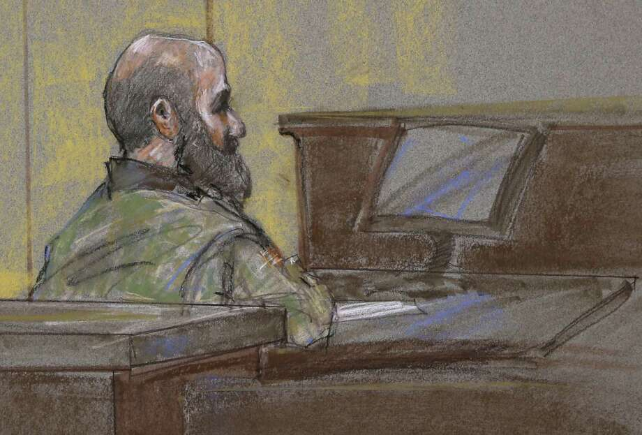 U.S. Army Maj. Nidal Malik Hasan is shown as the guilty verdict is read at his court-martial. Photo: Brigitte Woosley, FRE / FR170958 AP
