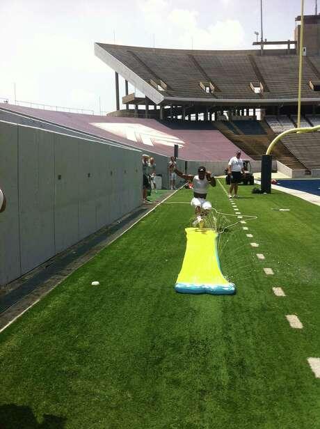 The Owls employ a Slip 'N Slide to teach their quarterbacks proper sliding technique. Photo: Joseph Duarte