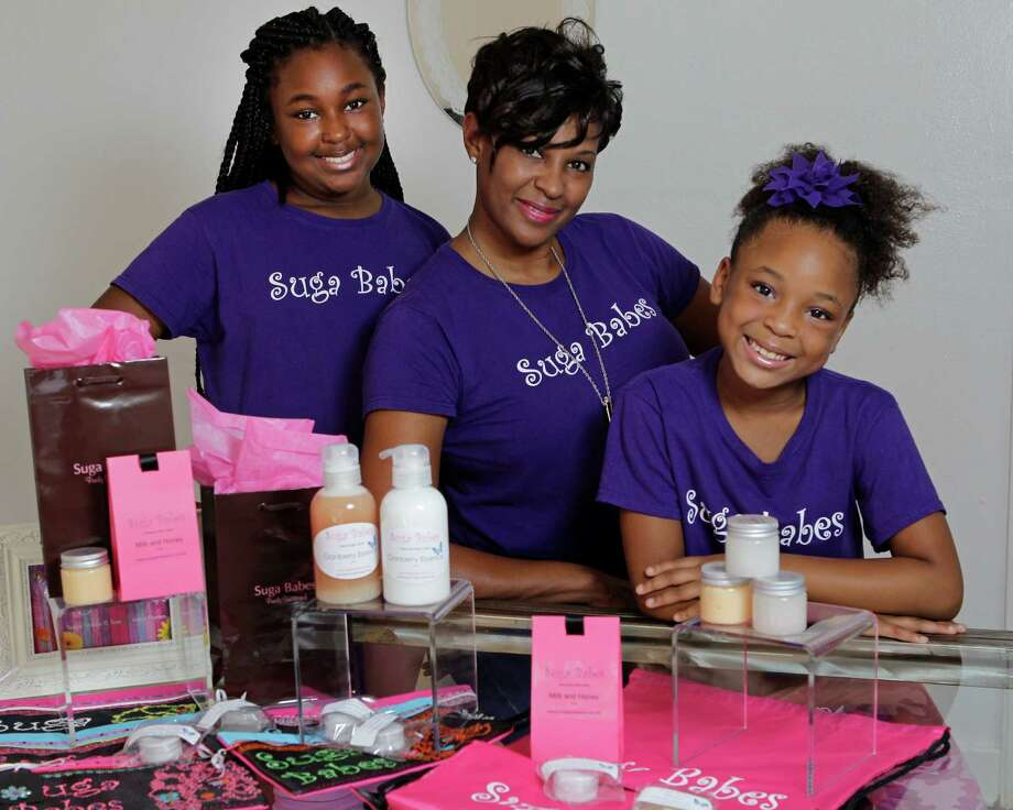 Layla Parish, left, Jacquie Parish and Mya Parish named their business Suga Babes. It offers sugar scrubs and lotions. Photo: Melissa Phillip, Staff / © 2013  Houston Chronicle