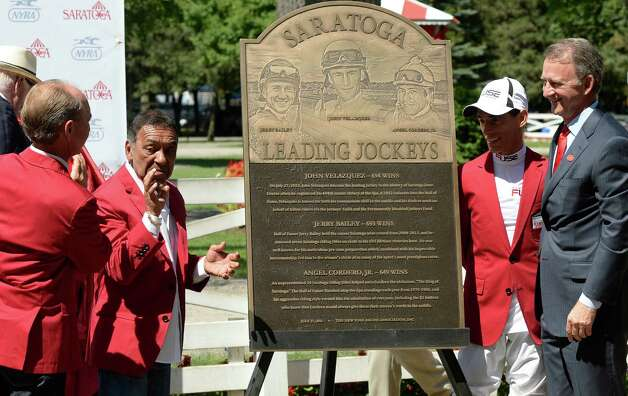 NYRA president Chris Kay, right, stands with jockeys Jerry Bailey, left, Angel Corder Jr., second from left, and John Velazquez, second from right, following the unveiling of a plaque honoring Saratoga?s winningest jockeys Friday afternoon, Aug. 23, 2013, at Saratoga Race Course in Saratoga Springs, N.Y. All three jockeys are members of Racing's Hall of Fame. (Skip Dickstein/Times Union) Photo: SKIP DICKSTEIN