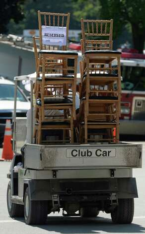 Rich Koch transports seating following Friday's  Aug. 23, 2013 at the Saratoga Race Course in Saratoga Springs, N.Y. All three jockeys are members of Racing's Hall of Fame.  (Skip Dickstein/Times Union) Photo: SKIP DICKSTEIN