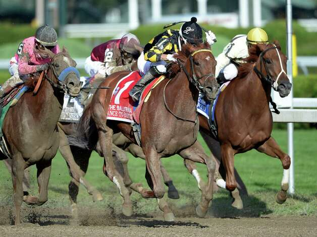 Dance to Briston, center with jockey Xavier Perez in the saddle held off a late charge from #5 Book Review with jockey Rafael Bejarano to win the 35th running of The Ballerina Aug 23, 2013, at the Saratoga Race Course in Saratoga Springs, N.Y. (Skip Dickstein/Times Union) Photo: SKIP DICKSTEIN