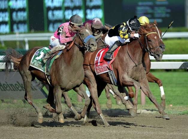 Dance to Bristol, center with jockey Xavier Perez in the saddle held off a late charge from #5 Book Review with jockey Rafael Bejarano to win the 35th running of The Ballerina Aug 23, 2013, at the Saratoga Race Course in Saratoga Springs, N.Y. (Skip Dickstein/Times Union) Photo: SKIP DICKSTEIN