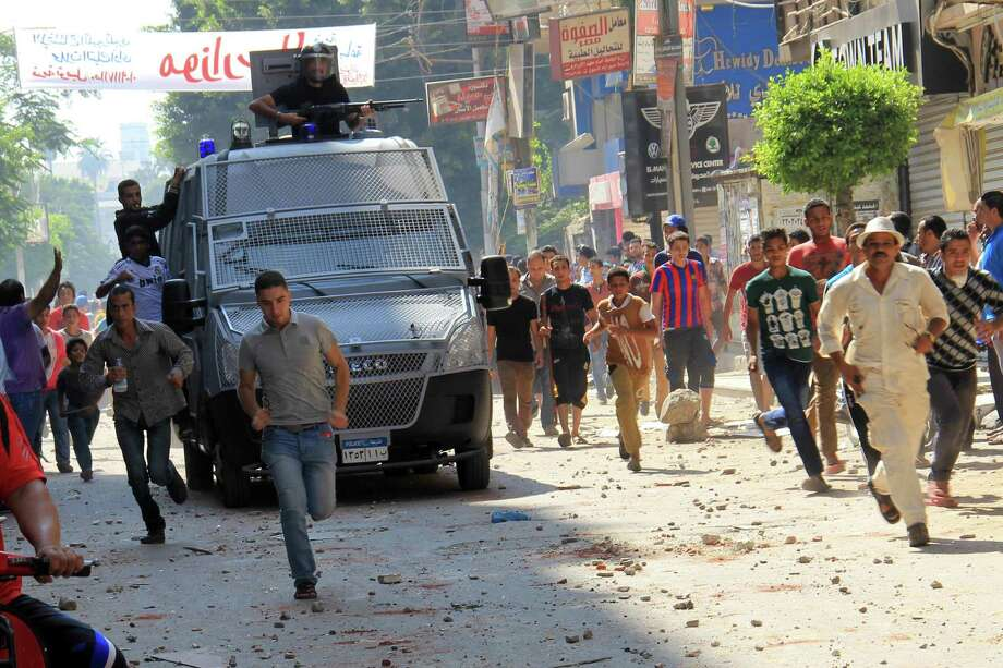 Egyptian security forces deploy Friday in Tanta where supporters of ousted President Mohammed Morsi clashed with residents, killing one. Hundreds of Morsi supporters took to the streets Friday in scattered rallies across Cairo. Photo: Associated Press