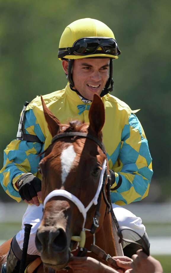 Joel Rosario sits atop Utopian Wife in the fourth race at the Saratoga Race course Aug. 2, 2013 in Saratoga Springs, N.Y.     (Skip Dickstein/Times Union) Photo: SKIP DICKSTEIN