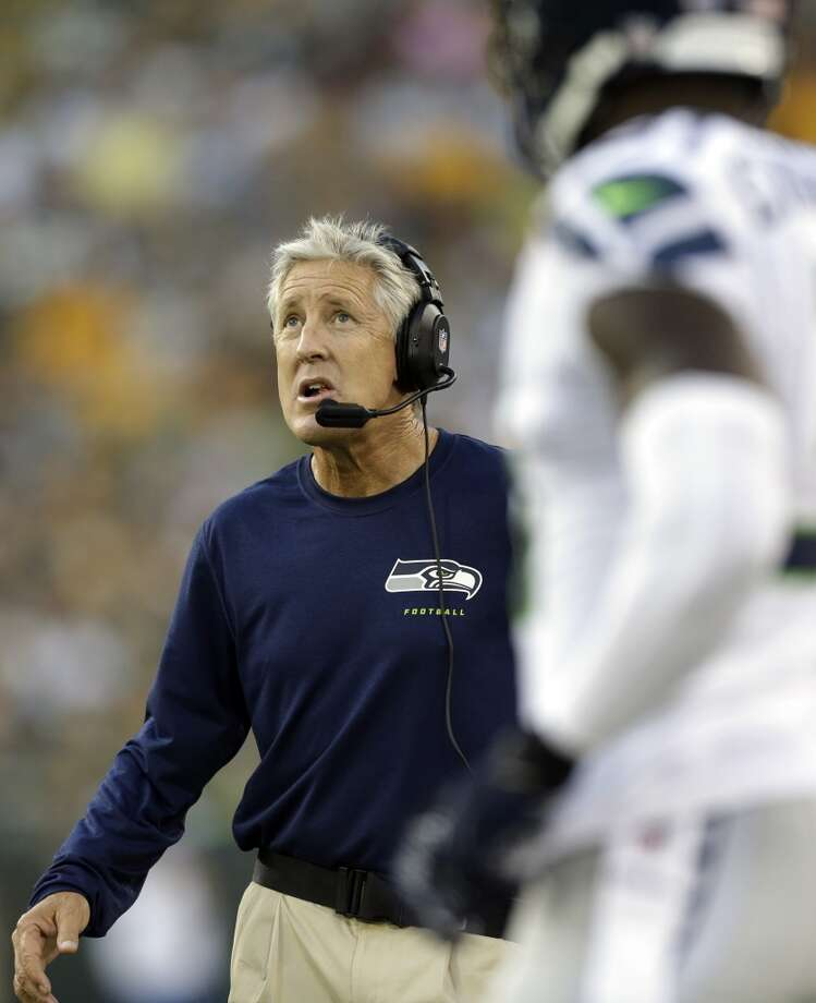 Seattle Seahawks head coach Pete Carroll looks at the scoreboard during the first half of an NFL preseason football game against the Green Bay Packers Friday, Aug. 23, 2013, in Green Bay, Wis. (AP Photo/Jeffrey Phelps) Photo: AP