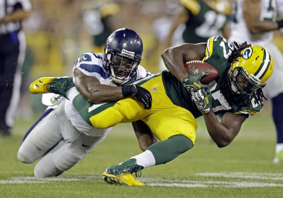 Seattle Seahawks' O'Brien Schofield tackles Green Bay Packers' Eddie Lacy during the first half of an NFL preseason football game Friday, Aug. 23, 2013, in Green Bay, Wis. (AP Photo/Jeffrey Phelps) Photo: AP