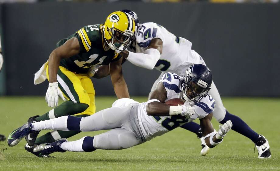 Seattle Seahawks' Walter Thurmond (28) recovers a fumble in front of Green Bay Packers' Jarrett Boykin during the first half of an NFL preseason football game Friday, Aug. 23, 2013, in Green Bay, Wis. (AP Photo/Tom Lynn) Photo: AP