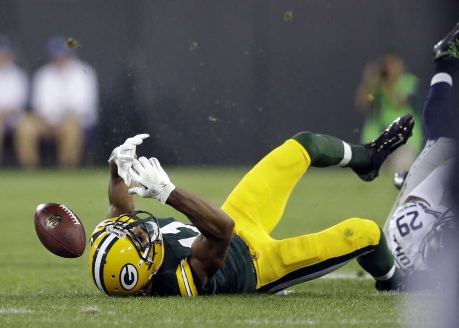 Green Bay Packers' Jarrett Boykin fumbles during the first half of an NFL preseason football game against the Seattle Seahawks Friday, Aug. 23, 2013, in Green Bay, Wis. (AP Photo/Morry Gash) Photo: AP