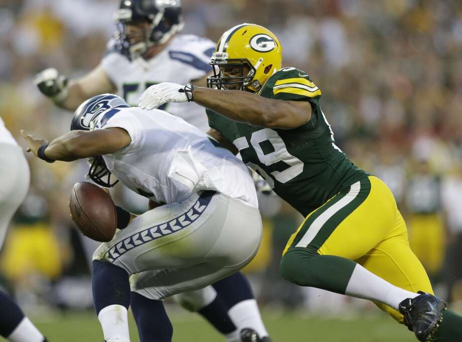 Green Bay Packers' Brad Jones sacks Seattle Seahawks' Russell Wilson during the first half of an NFL preseason football game Friday, Aug. 23, 2013, in Green Bay, Wis. (AP Photo/Jeffrey Phelps) Photo: AP