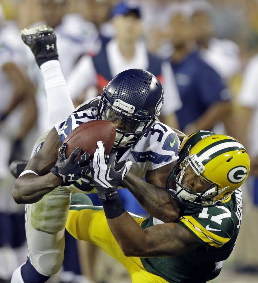 Seattle Seahawks' Will Blackmon catches a ball in front of Green Bay Packers' Charles Johnson (17) during the second half of an NFL preseason football game Friday, Aug. 23, 2013, in Green Bay, Wis. Blackmon was called for pass interference on the play. (AP Photo/Jeffrey Phelps) Photo: AP
