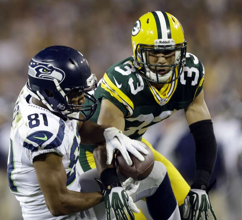 Green Bay Packers' Micah Hyde (33) breaks up a pass intended for Seattle Seahawks' Golden Tate (81) during the second half of an NFL preseason football game Friday, Aug. 23, 2013, in Green Bay, Wis. (AP Photo/Jeffrey Phelps) Photo: AP
