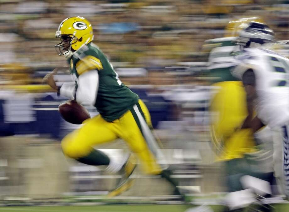 Green Bay Packers quarterback Vince Young runs with the ball during the second half of an NFL preseason football game against the Seattle Seahawks Friday, Aug. 23, 2013, in Green Bay, Wis. (AP Photo/Morry Gash) Photo: AP