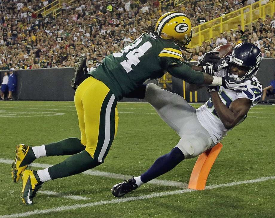 Green Bay Packers' Brandon Smith (34) breaks up a pass intended for Seattle Seahawks' Stephen Williams (83) during the second half of an NFL preseason football game Friday, Aug. 23, 2013, in Green Bay, Wis. (AP Photo/Morry Gash) Photo: AP