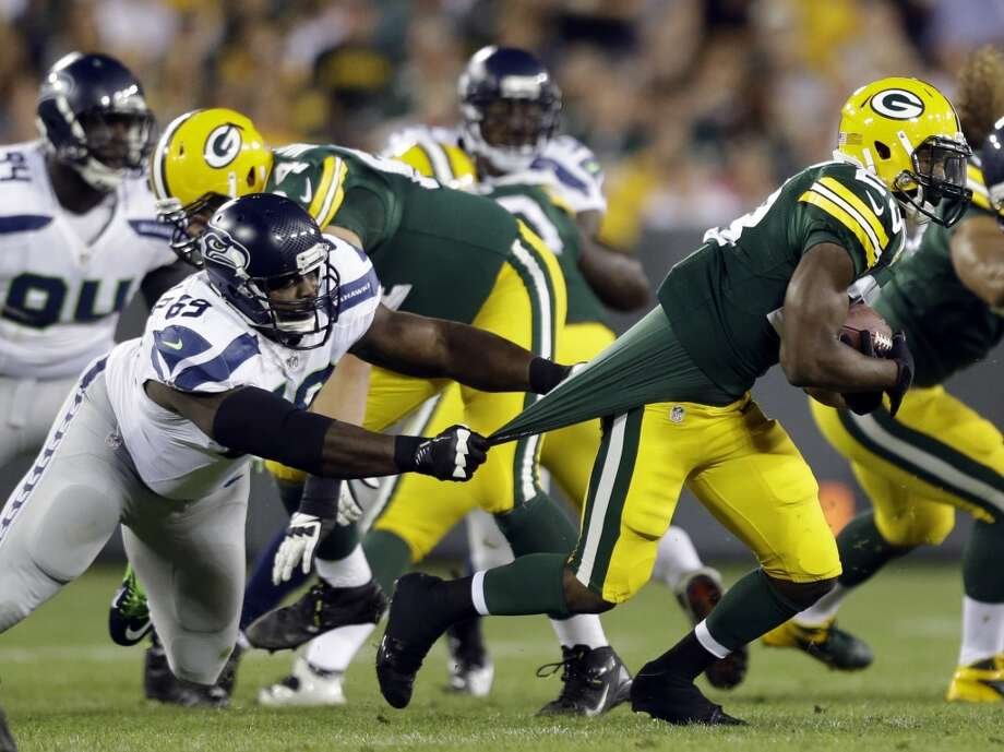 Seattle Seahawks' Clinton McDonald (69) tries to stop Green Bay Packers' Johnathan Franklin during the second half of an NFL preseason football game Friday, Aug. 23, 2013, in Green Bay, Wis. (AP Photo/Jeffrey Phelps) Photo: AP