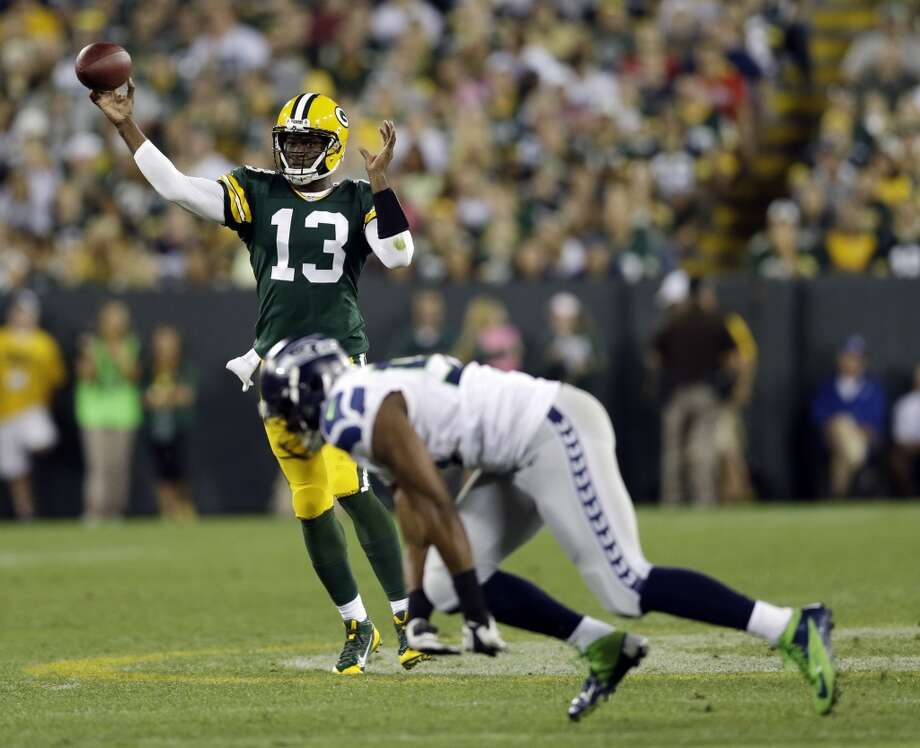 Green Bay Packers Vince Young throws during the second half of an NFL preseason football game against the Seattle Seahawks Friday, Aug. 23, 2013, in Green Bay, Wis. (AP Photo/Tom Lynn) Photo: AP