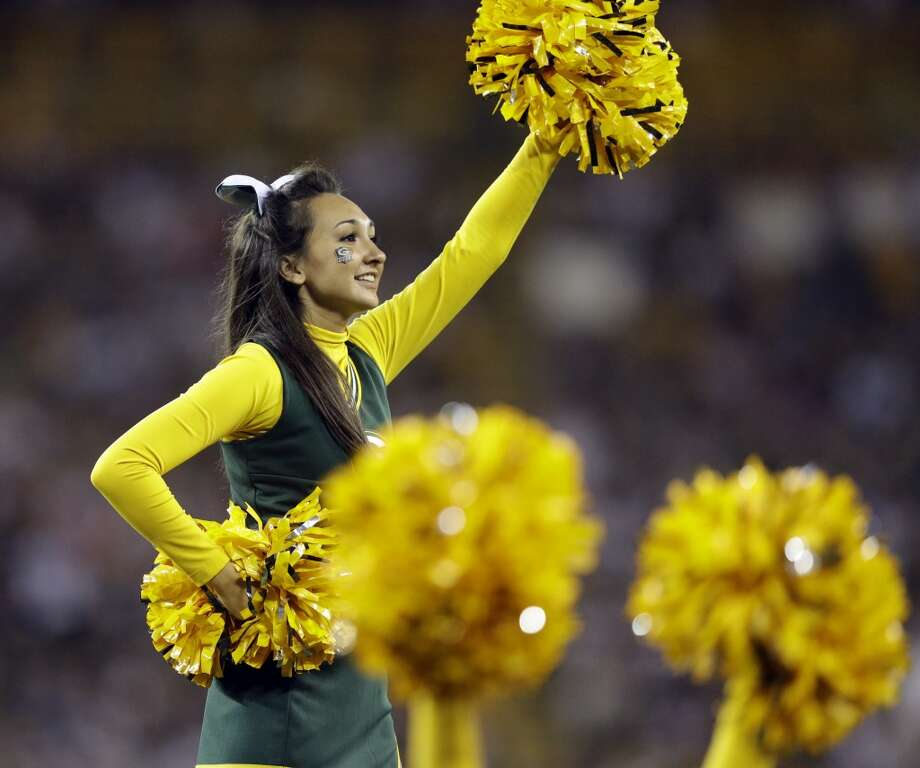 A cheerleader performs during the second half of an NFL preseason football game between the Green Bay Packers and the Seattle Seahawks Friday, Aug. 23, 2013, in Green Bay, Wis. (AP Photo/Morry Gash) Photo: AP