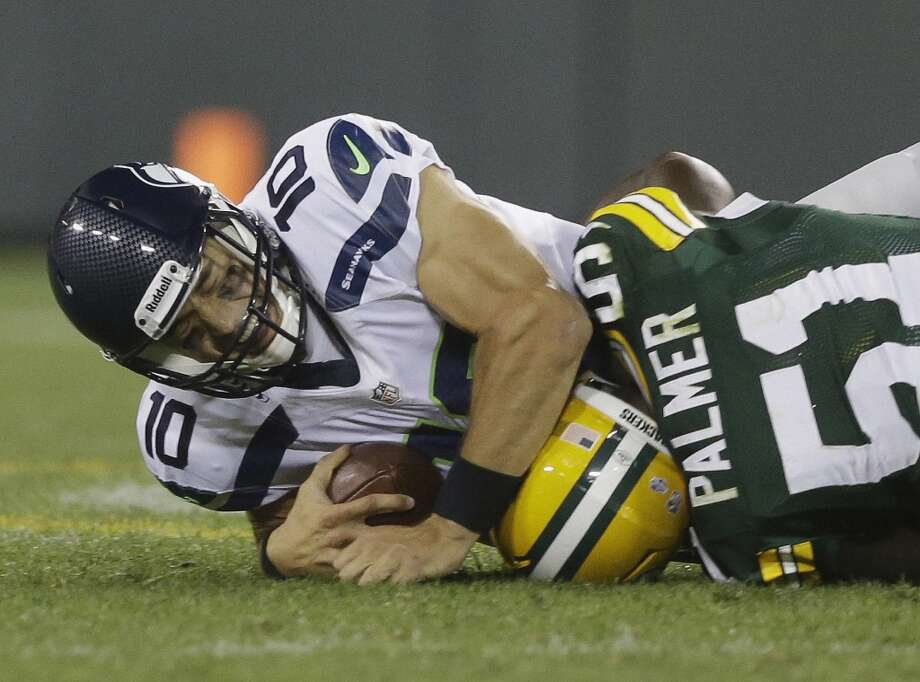 Green Bay Packers' Nate Palmer sacks Seattle Seahawks' Brady Quinn during the second half of an NFL preseason football game Friday, Aug. 23, 2013, in Green Bay, Wis. (AP Photo/Morry Gash) Photo: AP